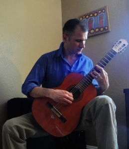Cyril Bussiere playing guitar