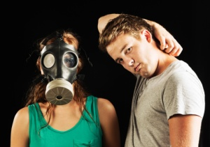 Man with Bad breath and woman with Gas mask on