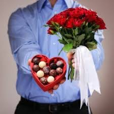 man_giving_roses_and_candy.jpg