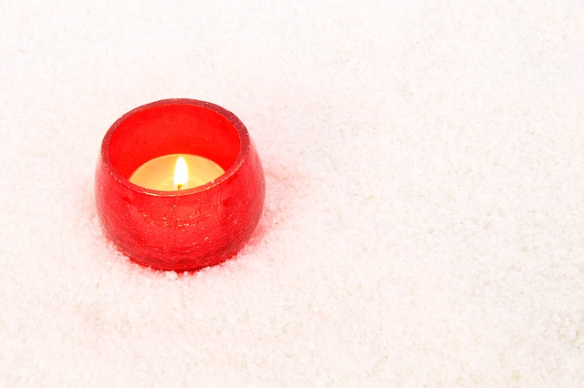 burning_candle_snow.jpg