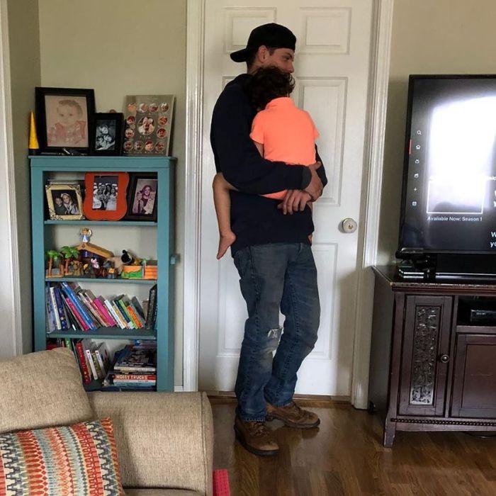 Calbe man holding customer's son.